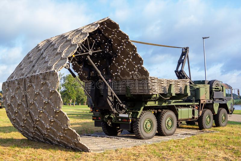 Military truck with folding street device stock images