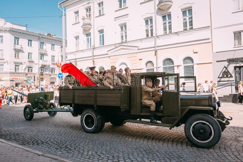 Military truck with the Red Army in the streets of Gomel. Belarus. Gomel, Belarus - May 9, 2018: Military truck with a cannon in a trailer and with soldiers of royalty free stock photos