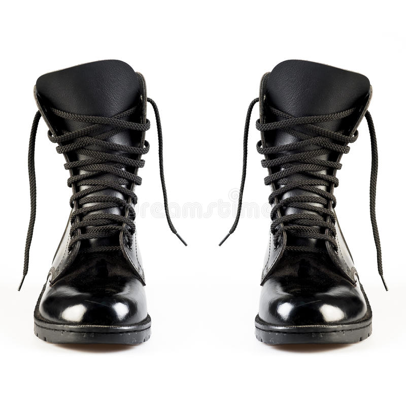 Military Uniform Black Leather Combat Boots. On white background stock photography