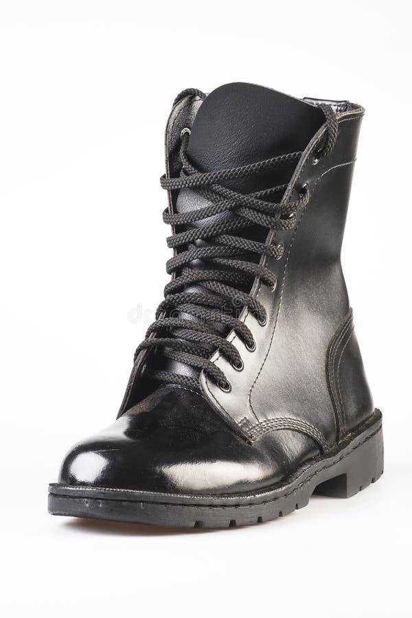 Military Uniform Black Leather Combat Boots. On white background stock photo
