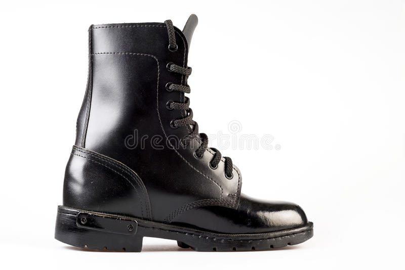 Military Uniform Black Leather Combat Boots. On white background royalty free stock photography