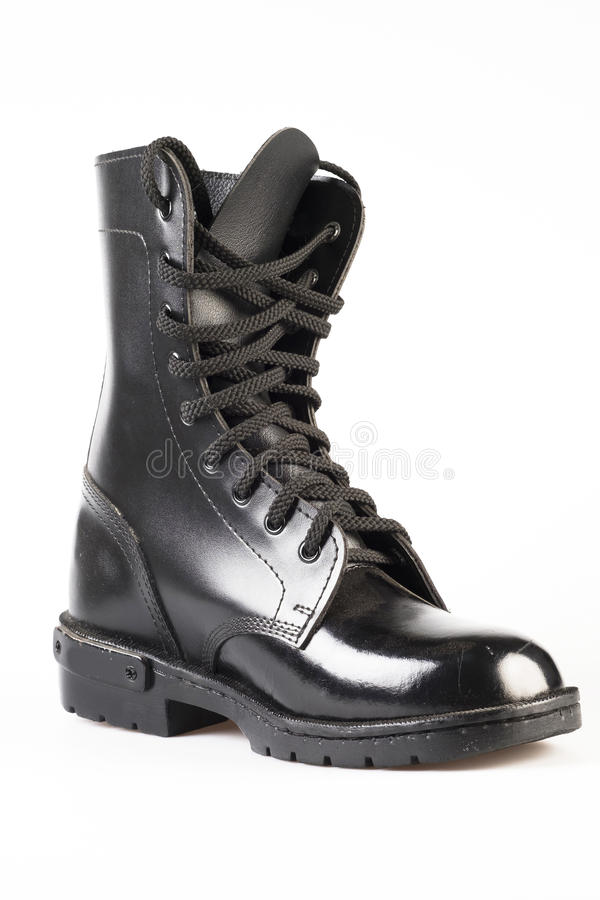 Military Uniform Black Leather Combat Boots. On white background royalty free stock images