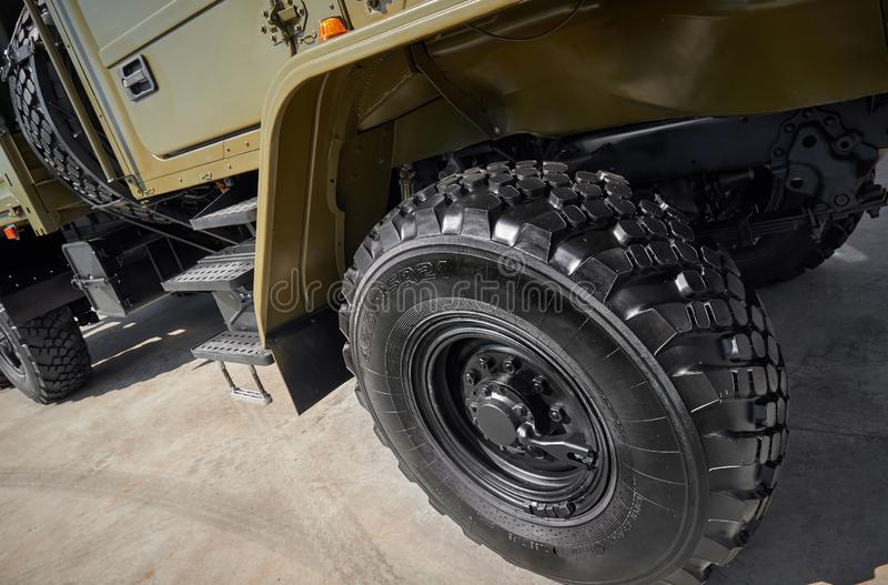 Military vehicle truck wheels on hub with black shine tires. New clean off road transport truck all terrain wheels for. High resol royalty free stock image