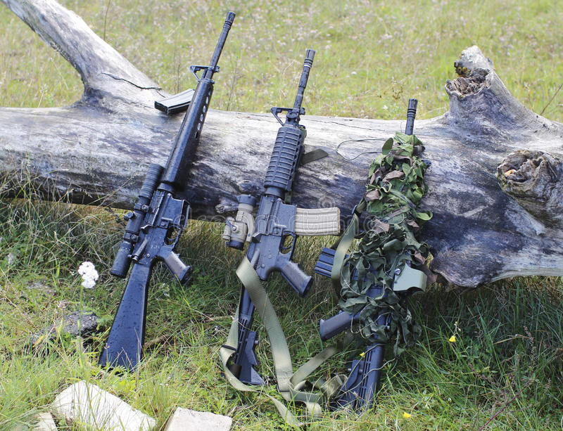 Military weapons for airsoft in a clearing