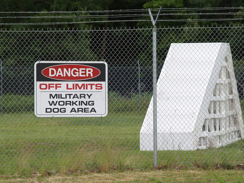Military Working Dog Area. A sign on a fence around a Military Working Dog Area royalty free stock image