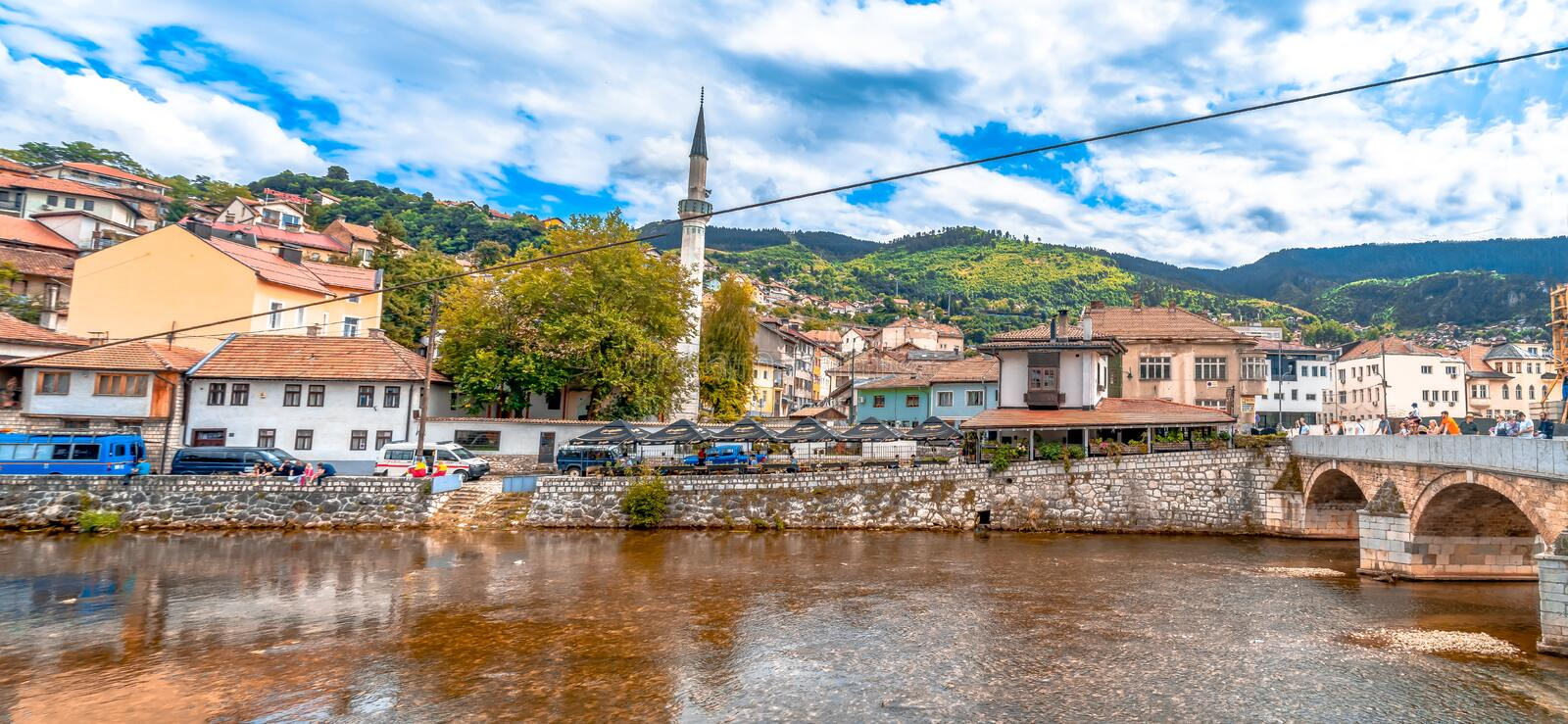 Miljacka River and Bridges in Sarajevo. SARAJEVO, BOSNIA - AUGUST 3, 2019 : Houses near Miljacka river and bridges with Inat Kuca House of Spice. The old town is stock photos