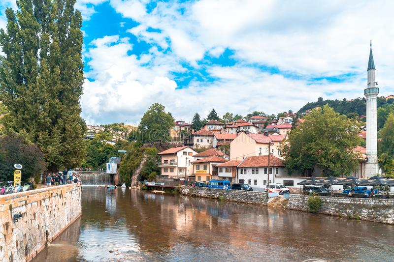 Miljacka River and Bridges in Sarajevo. SARAJEVO, BOSNIA - AUGUST 3, 2019 : Houses near Miljacka river and bridges. The old town is most popular place for royalty free stock photos