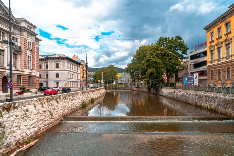 Miljacka River and Bridges in Sarajevo. SARAJEVO, BOSNIA - AUGUST 3, 2019 : Houses near Miljacka river and bridges. The old town is most popular place for stock photo