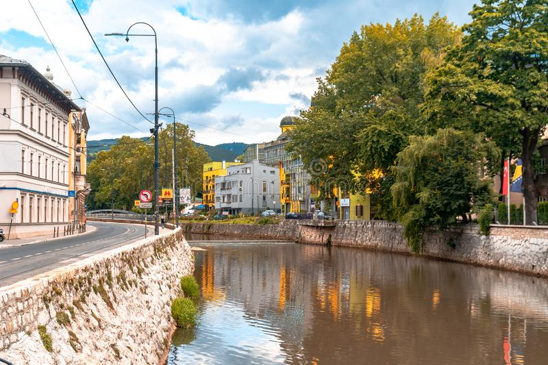 Miljacka River and Bridges in Sarajevo. SARAJEVO, BOSNIA - AUGUST 3, 2019 : Houses near Miljacka river and bridges. The old town is most popular place for stock images