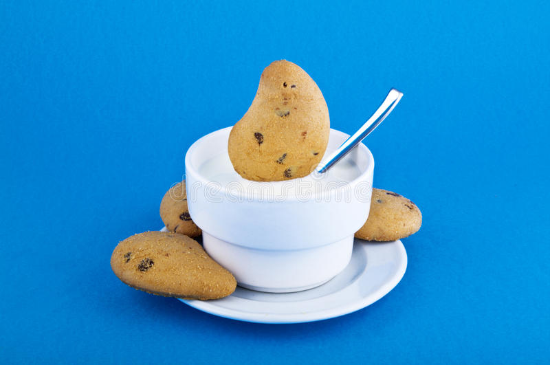 Milk and biscuits royalty free stock image