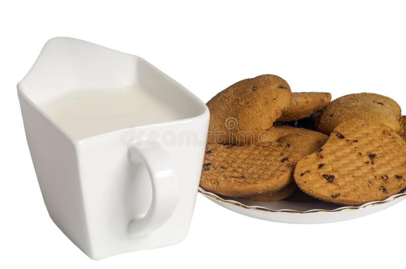 Milk and biscuits with chocolate drops stock images