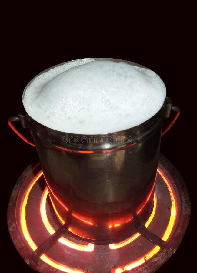 Milk on boil stock images