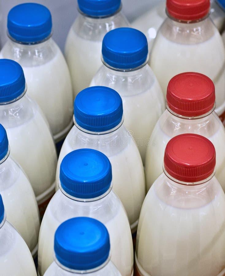 Milk bottles in a supermarket royalty free stock image