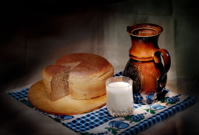 Milk and bread. Still-life with milk and bread royalty free stock photo