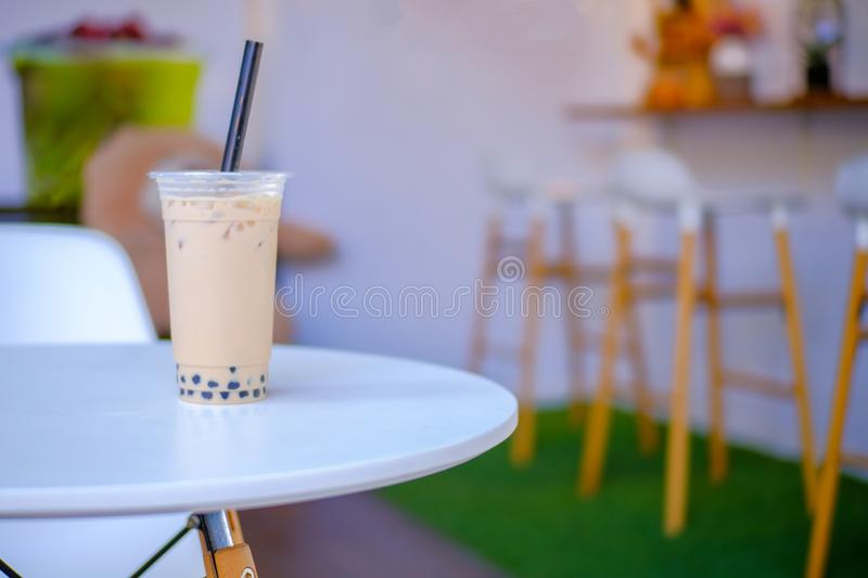 Milk bubble tea in takeaway glass, Homemade Milk Tea with Tapioca Pearls with copy space. Selective focus royalty free stock photography