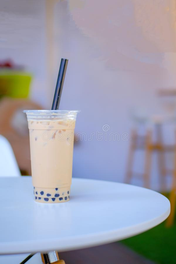 Milk bubble tea in takeaway glass, Homemade Milk Tea with Tapioca Pearls with copy space. Selective focus stock photography