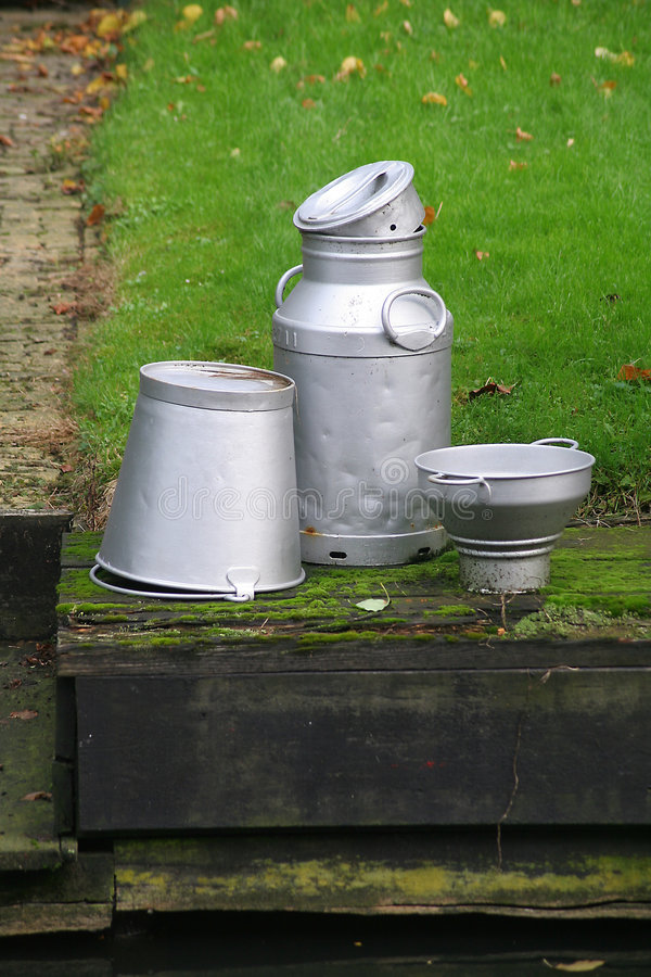 Milk can and buckets royalty free stock images