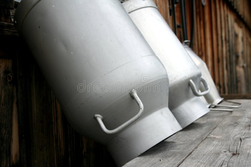 Milk cans royalty free stock photography