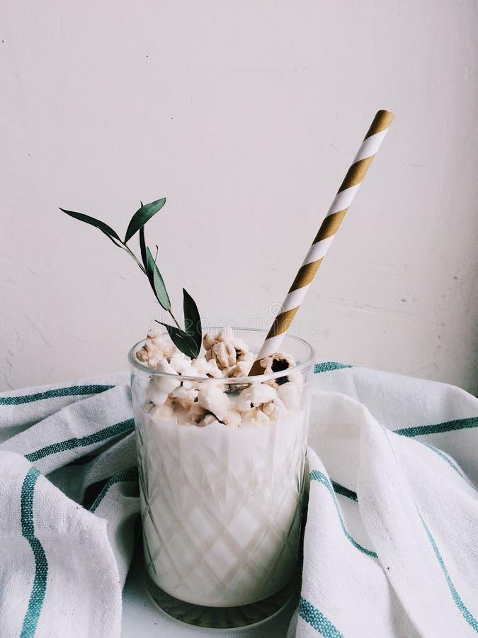 Milk with caramel popcorn on white background royalty free stock photography
