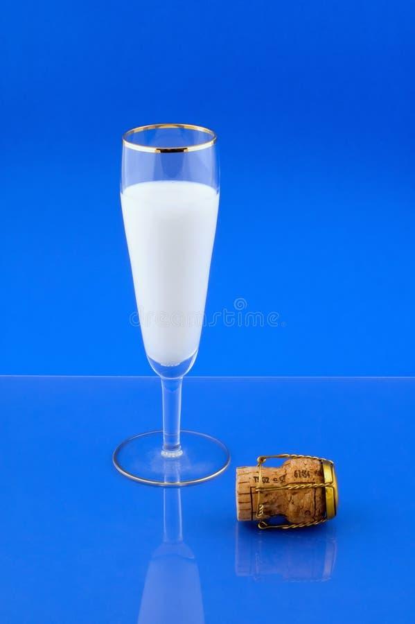 Milk and Champagne cork stock photo