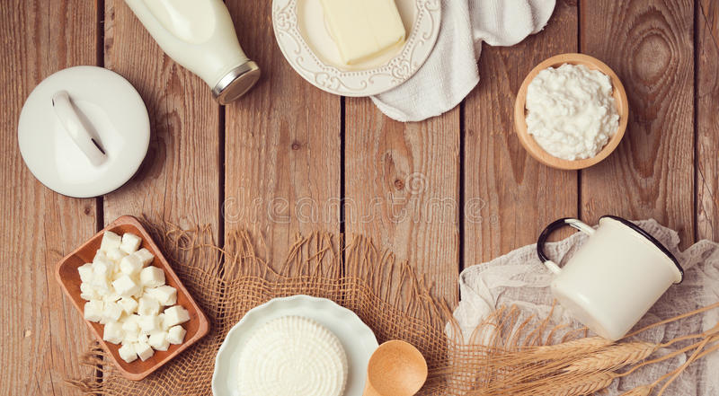 Milk and cheese on wooden background. Jewish holiday shavuot celebration. View from above. stock photos