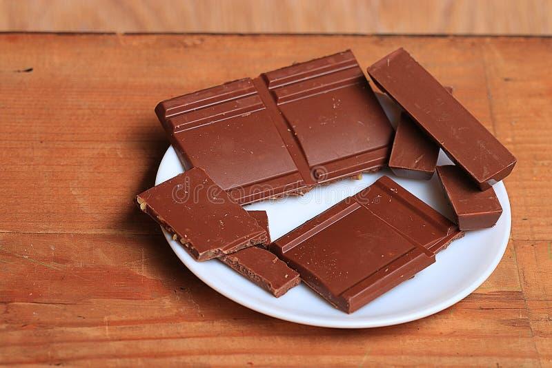 Milk chocolate background. Sweet pieces of milk chocolate background royalty free stock image