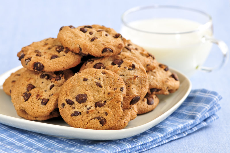 Milk and chocolate chip cookies stock photos