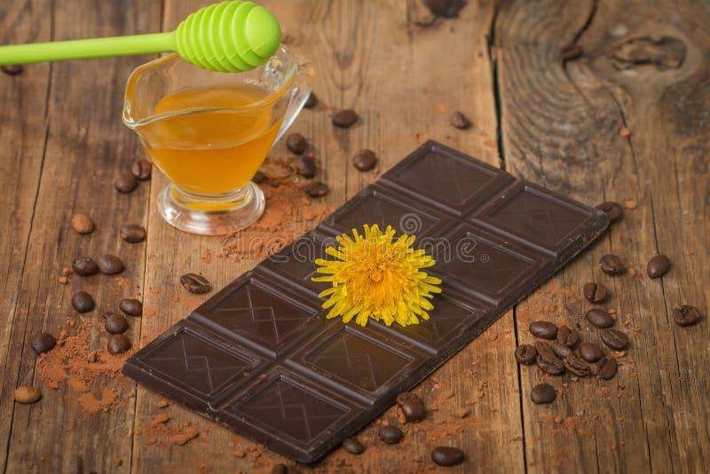 Milk chocolate with honey stock photos