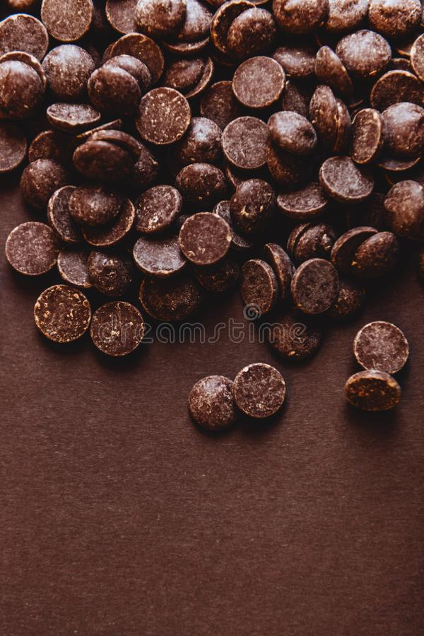 Milk chocolate pieces preform candies in daylight. For background royalty free stock images