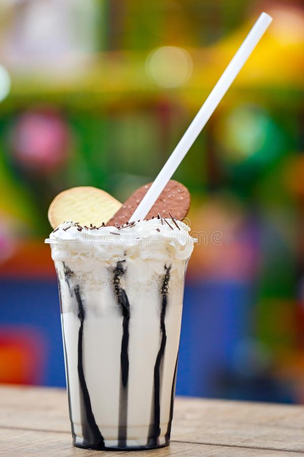 Milk cocktail decorated with confectionery. Cold sweet dessert. Milk cocktail decorated with confectionery. Cold sweet dessert royalty free stock photography