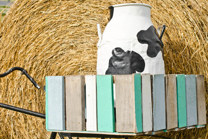Milk container black and white. Milk container black and white In a wooden box stock image