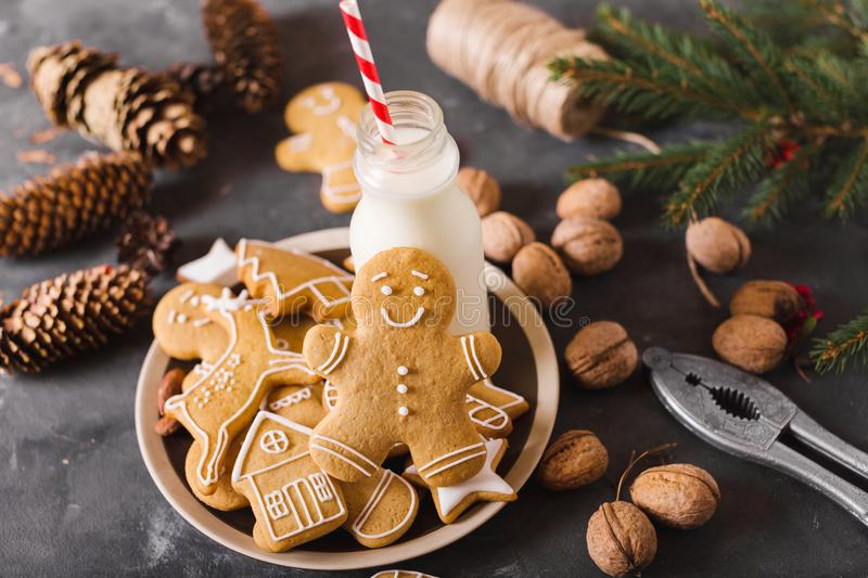 Milk and cookies. Gingerbread cookies on a gray background. Christmas cookies. Ginger men stock photo