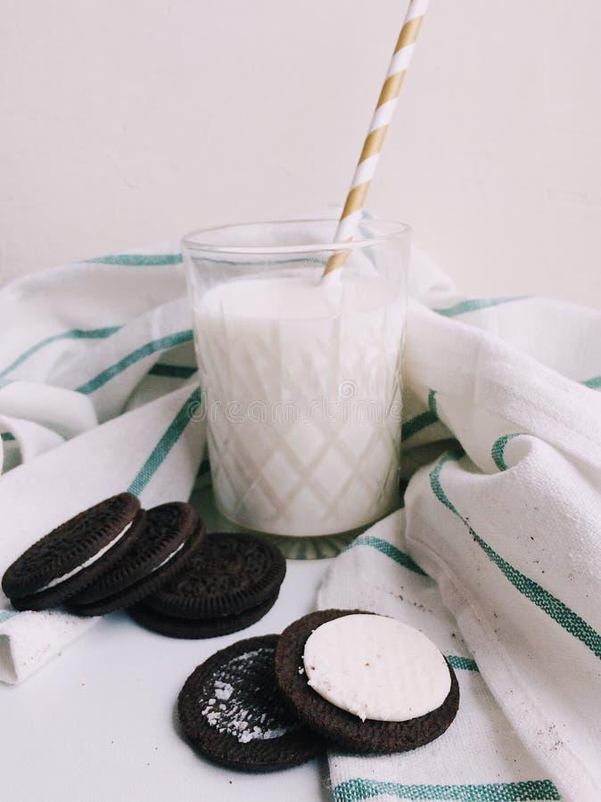 Milk with cookies Oreo on white background stock photos