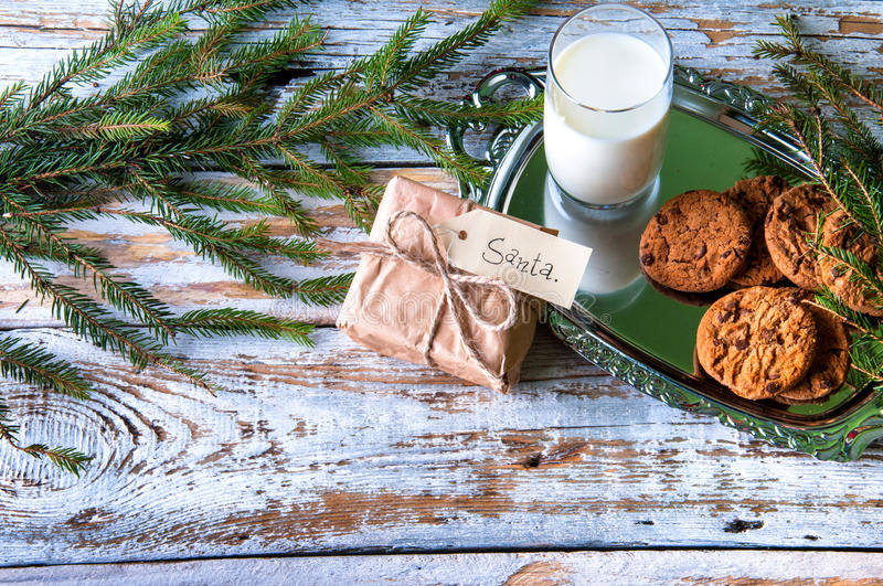 Milk, cookies and some gift for Santa stock images