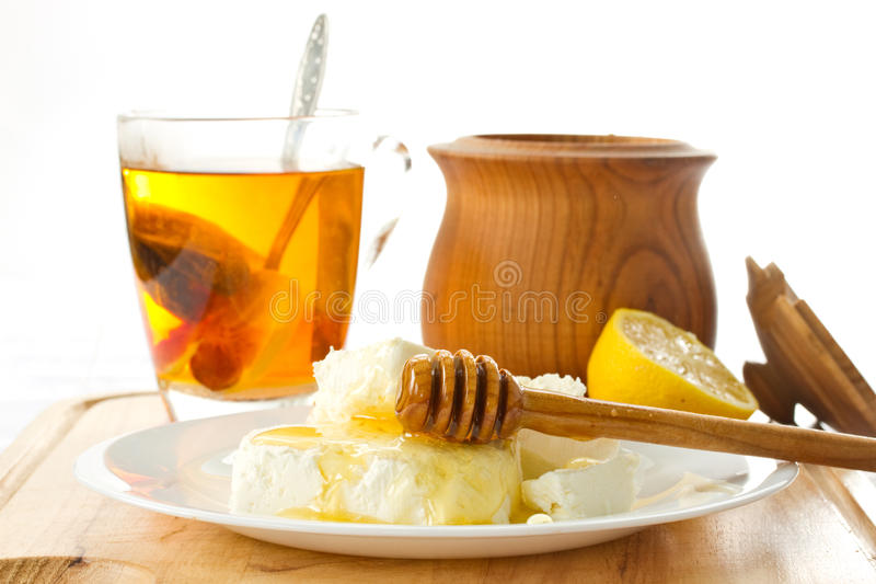 Milk cottage cheese with honey royalty free stock images