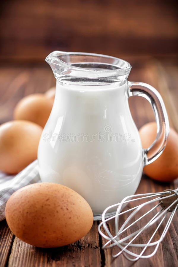 Milk and eggs stock images