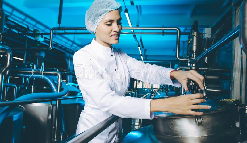Milk factory production. Industrial worker machinery technology royalty free stock images