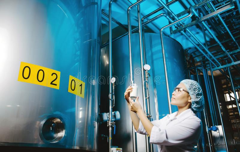 Milk factory production. Industrial worker machinery technology stock photography