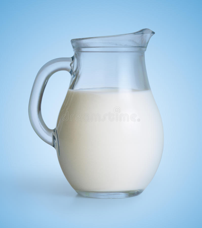 Milk glass jug on blue royalty free stock photo