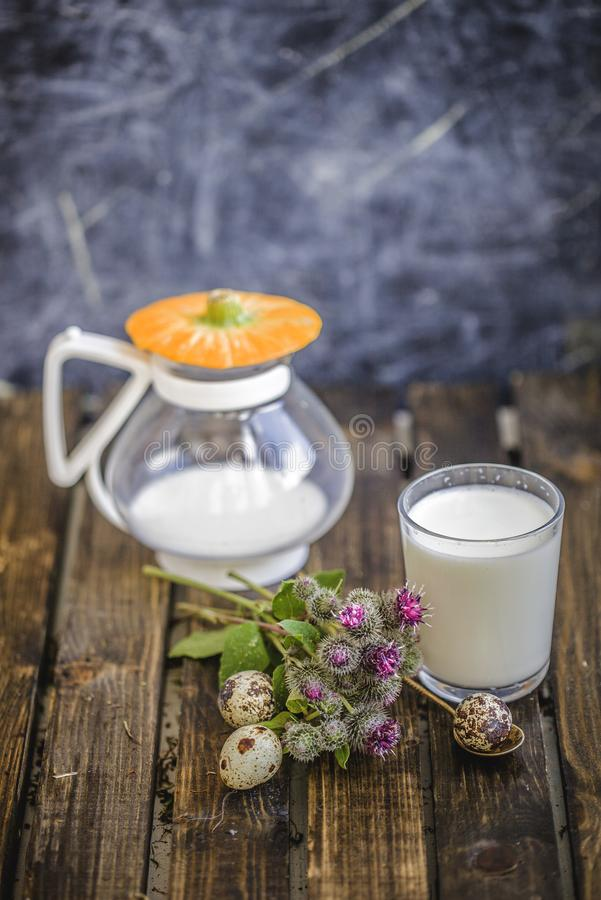 Milk in glass spilled on table with delicious kids idea. Milk in a glass spilled on the table. delicious, the children idea for Breakfast .happiness is pleasure stock images