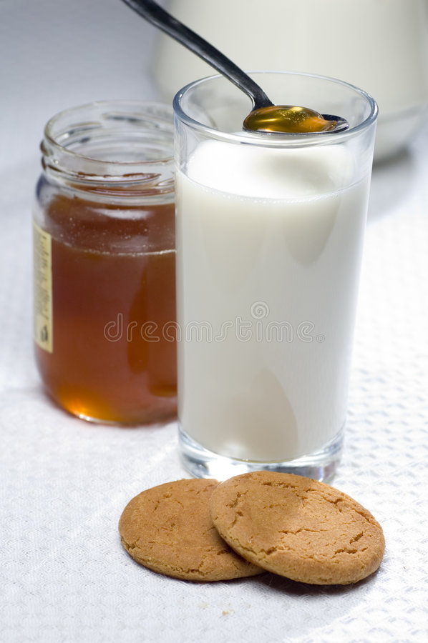 Milk and honey royalty free stock photography