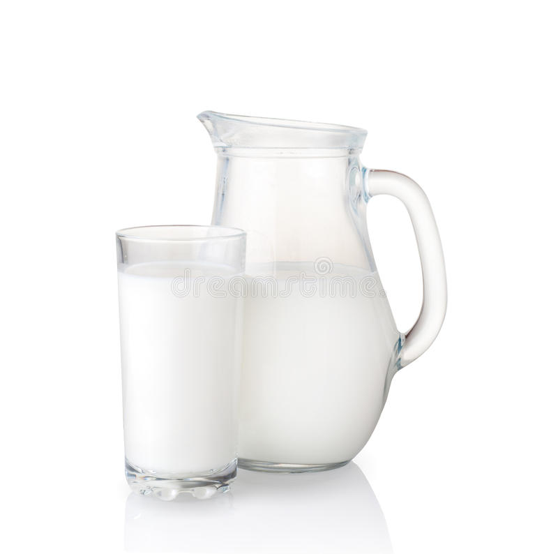 Milk jug and glass. royalty free stock images