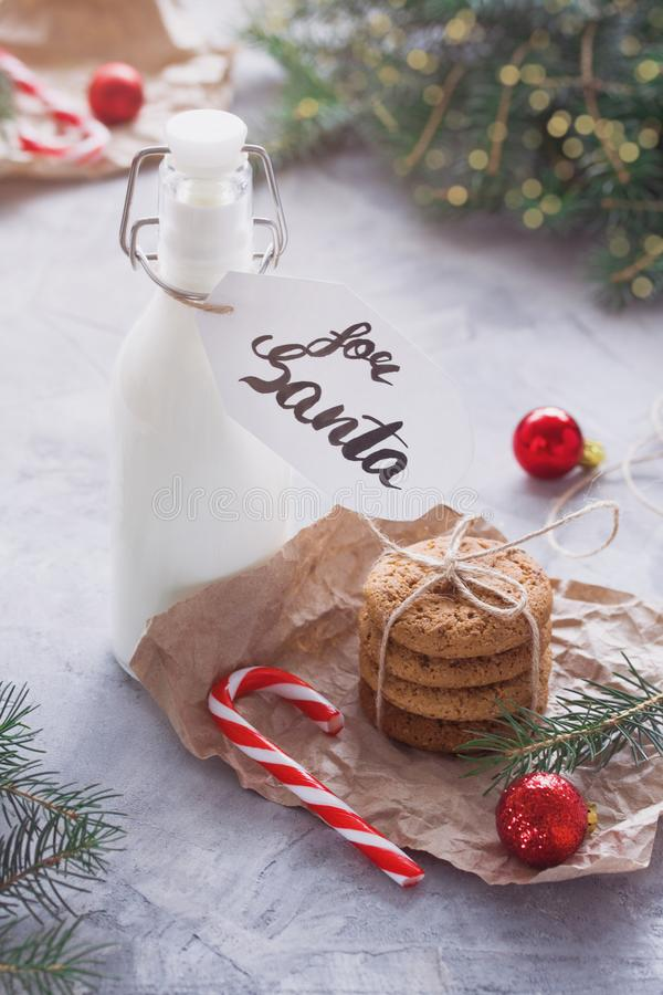 Milk and Oatmeal cookies for Santa Claus royalty free stock photography