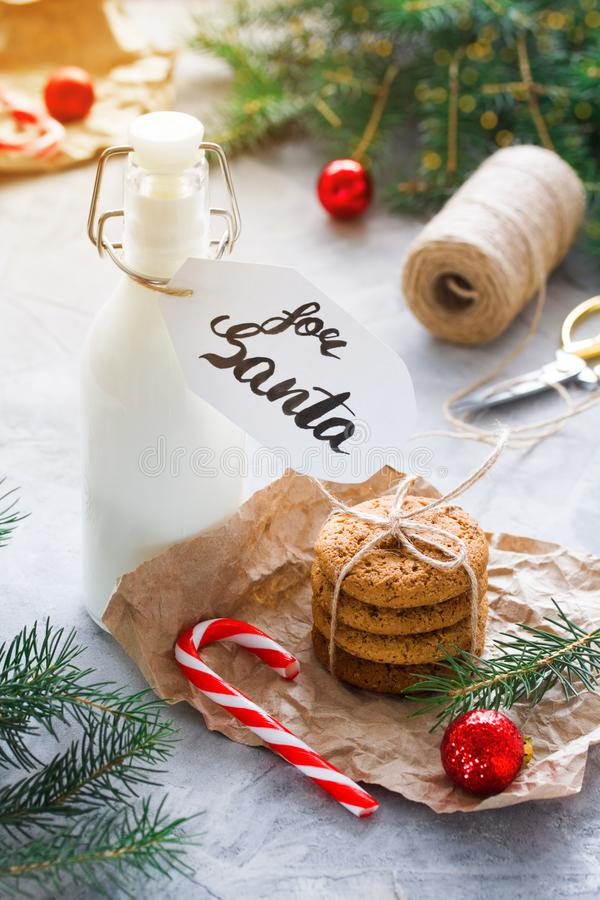 Milk and Oatmeal cookies for Santa Claus royalty free stock image