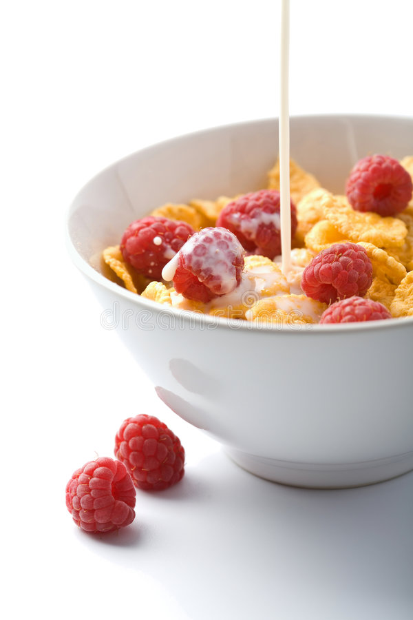 Download Milk Pouring Onto Muesli With Raspberry Isolated Royalty Free Stock Image - Image: 7068606