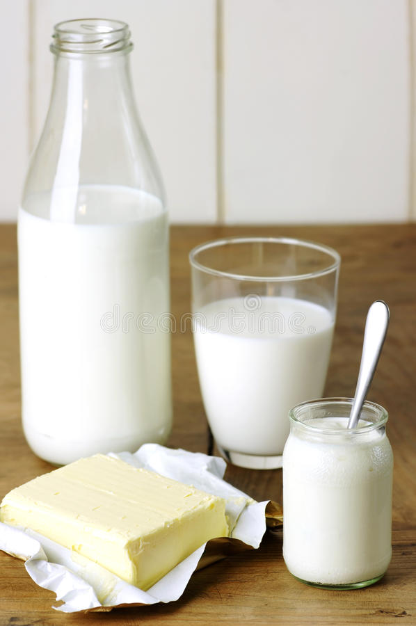 Milk products. Milk, yoghurt, butter and eggs on a wooden table stock photo