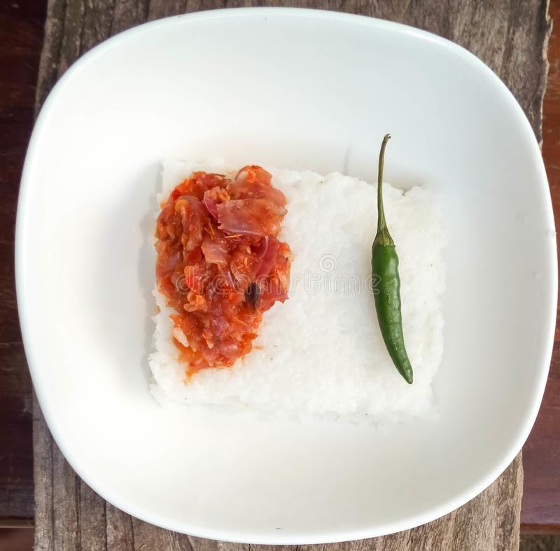 Milk rice and hot chilli stock image