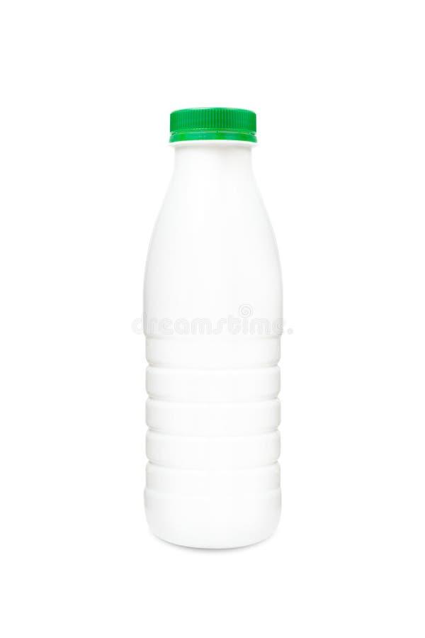 Milk or shampoo plastic bottle with green cap. Isolatedon one white background royalty free stock photos