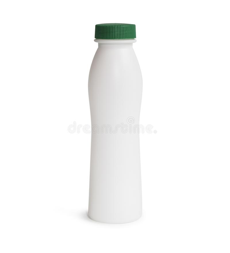 Milk or shampoo plastic bottle with green cap. Isolated on white background stock photos