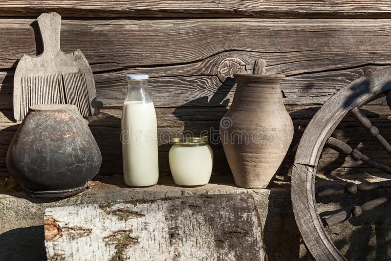 Old country ware and utensils. Milk and sour cream Vintage interior, old country ware and utensils royalty free stock photography
